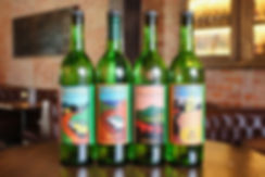 Four bottles of Mezcal on a table