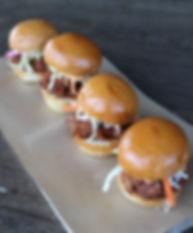 4 mini sliders on a plate