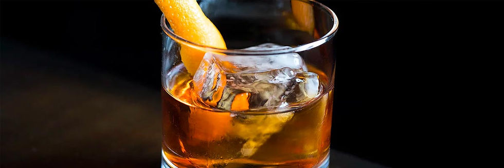Cocktail in rocks glass with citrus garnish