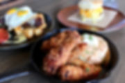 Frid chicken and other brunch plates on a table