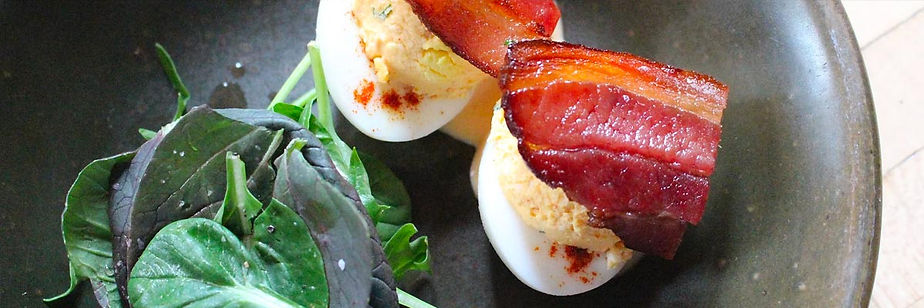 Bacon, deviled eggs and greens
