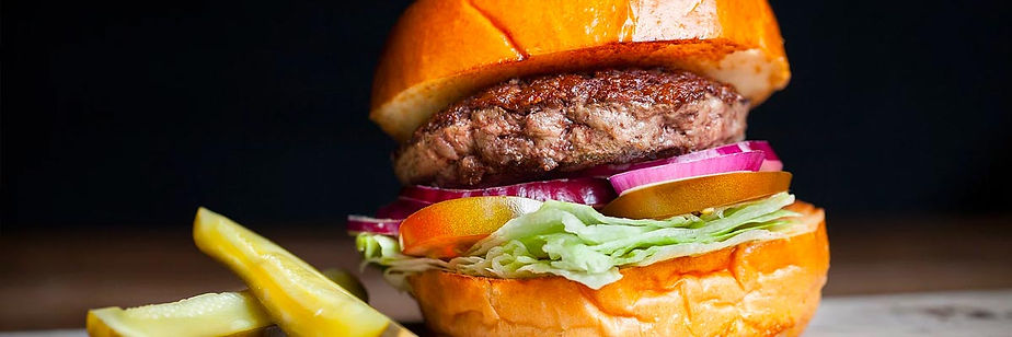 Classic hamburger with w/ lettuce, vine-ripe tomato and onion