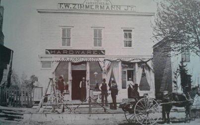Fred W. Zimmerman Jr. Standing in the doorway of his hardware store, established 1886