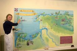 Liz next to map mural Heddon Valley nati