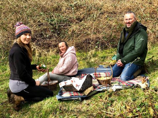Liz on picnic blanket foraging Jason Bro