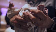 grandpa holds newborn feet