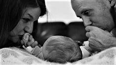 fresh 48 mom and dad kiss newborn baby