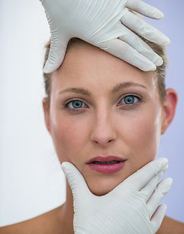 doctor-examining-female-patients-face-from-cosmetic-treatment.jpg