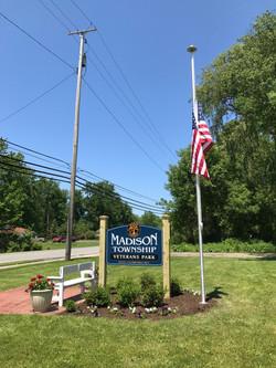 Veterans Park Sign an Flagpole