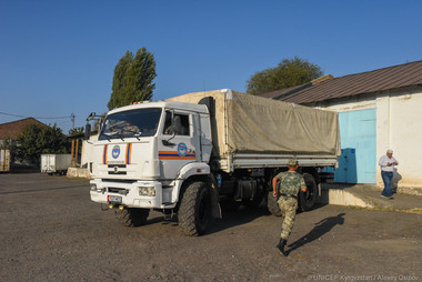 Humanitarian aid equipment transfer in Osh with Military forces.