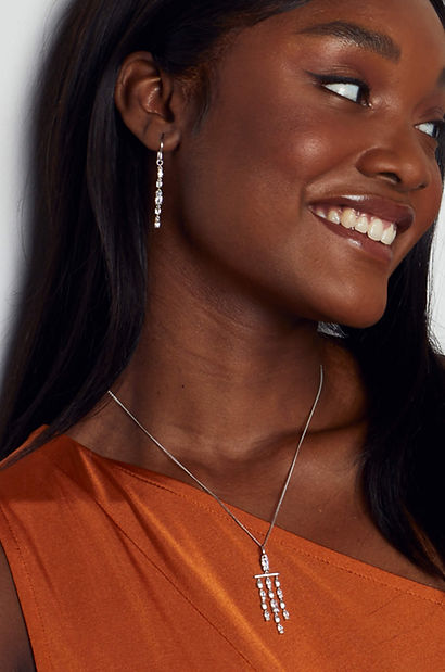 Sparkly jewellery set of dangly earrings and necklace