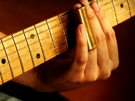 4 Ways to Make Sure You Don't Suck at Slide Guitar