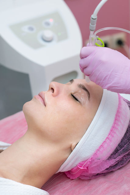 Woman getting face peeling procedure in