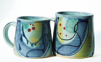 Large and standard mug in high fired stoneware clay, hand thrown and decorated by Devon potter Lea Phillips