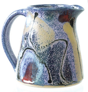 Stoneware milk jug hand made in Devon by Lea Phillips, cosmic design