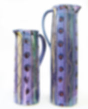 Two tall jugs in cosmic design