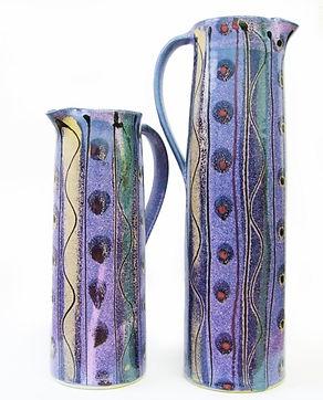 Two tall jugs in cosmic design