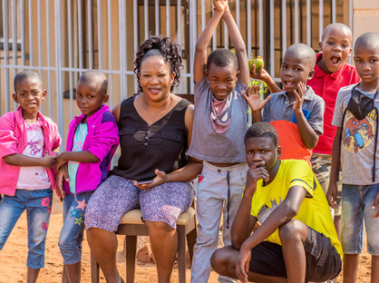Mama Sima with Kids at Rose of Charity