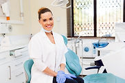 female dentist and dental chair