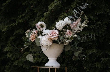 Ceremony florals with peonies roses dahlias and ranunculus.jpg