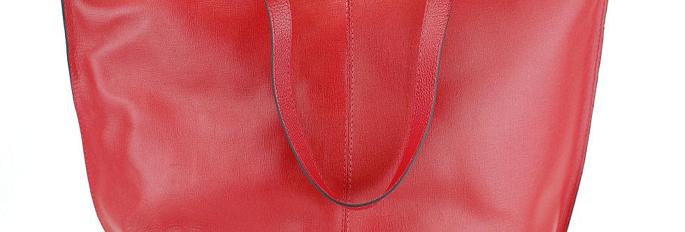 Bolsa de couro com tachas laterais