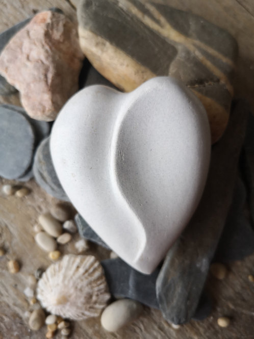 SCULPTED HOLDING HEART