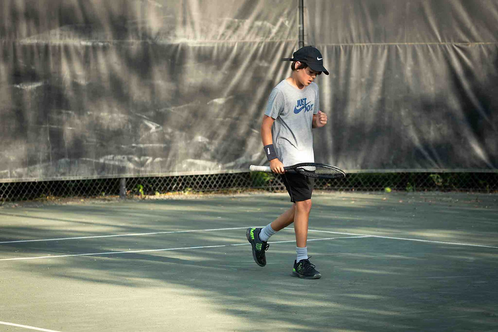 Juggle the tennis on the frame of your racquet