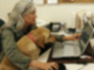 Diane with dog at desk CROPPED (1).jpeg