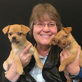 Denise Stevens with puppies.jpg
