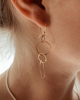 Gold Link Drop Earrings on ear