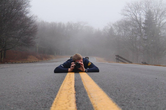 Jacob Thompson laying on road