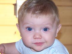 Bright blue eyes of Alex Thompson