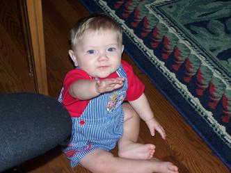 Baby Alex Thompson reaching