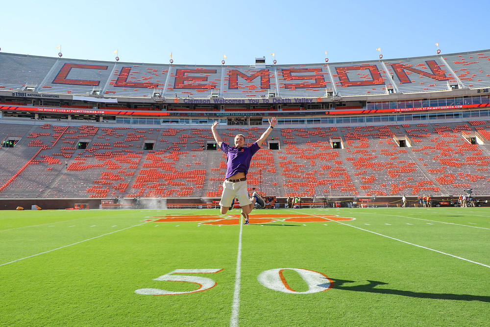 Jacob Thompson Clemson student jumping football