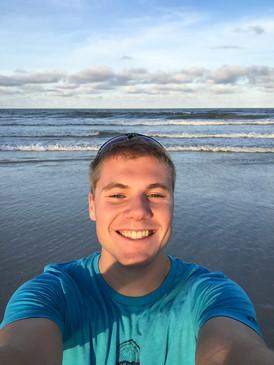 Jacob Thompson at a beach