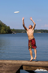 Jacob Thompson frisbee shirtless jumping