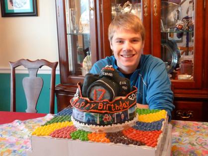 Jacob Thompson with camera birthday cake canon
