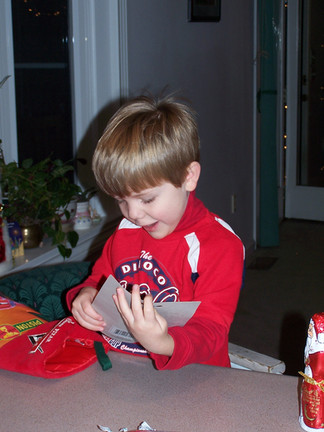 Christmas Alex opening his stocking