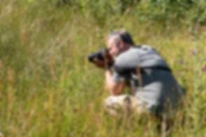 Kieran taking a photo of a butterfly