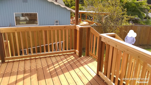 Complete rebuild of deck with sunwood deckboards, new railing system, brandnew stairs, and a new clear-roof awning