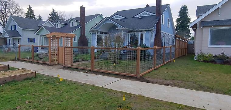 Custom Hogwire Fence with Full Cedar Arbor Gate