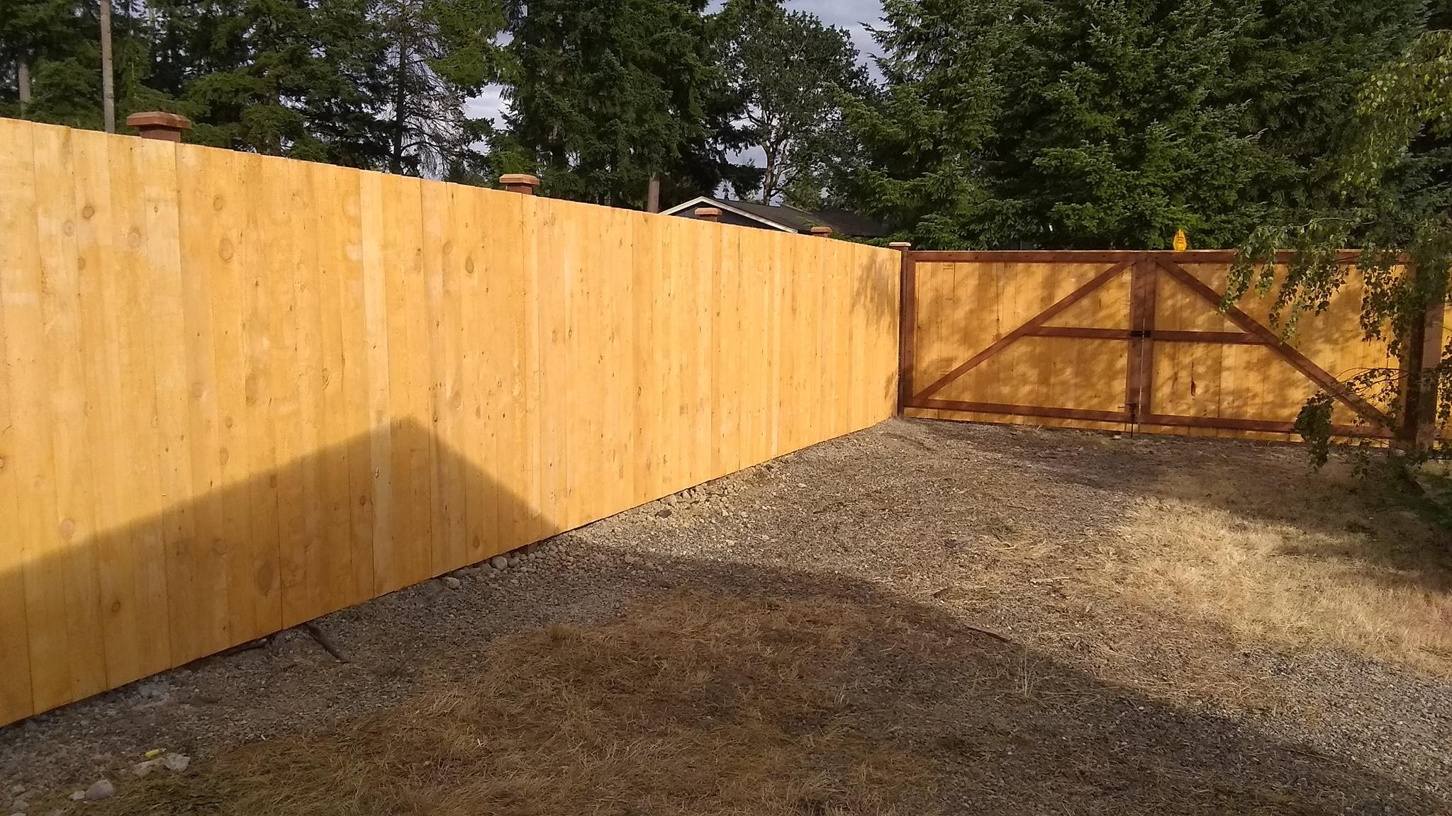 Prestain Straightboard Fence