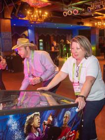 Woman playing pinball