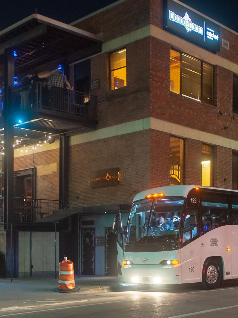 Coach bus shuttle parked outside VIP event venue