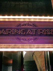 Roaring at Rising signage