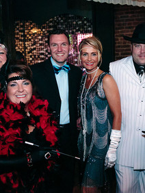 Attendees of Roaring customer appreciation event dressed in 1920s outfits