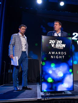 CEO presenting at awards ceremony