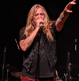 Sebastian Bach performing at corporate evening event with Royal Machines