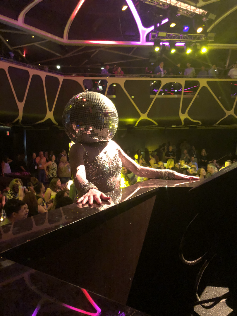 Dancer with disco ball mask