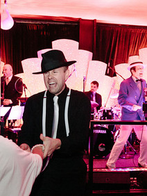 Couple swing dancing at twenties themed party
